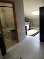 Baño de Habitación en Buhardilla