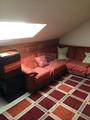 Sala de estar de habitación en Buhardilla
