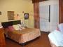 Dormitorio 1 con baño en planta calle