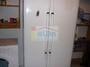 Cuarto despensa, con lavadora y frigorífico